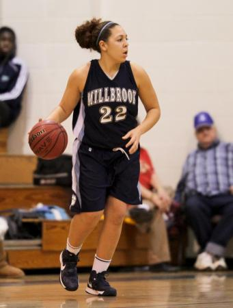 Millbrook's #22 Katelyn Mitchell looks to pass as Leesville Road hosted Millbrook Friday night January 11, 2013. (Photo by Jack Tarr)
