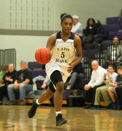 Holly Springs #5 Kiara Leslie (C) on the fast break during the game Thursday January 31, 2013. (Photo by Jack Tarr)