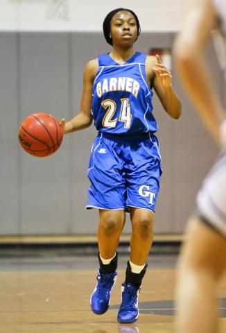 Garner's # 24 Kiyana Stokes brings the ball up court during the game Wednesday February 6, 2013  (Photo by Jack Tarr)