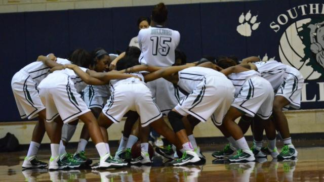 Southeast Raleigh High School defeats Laney 44 to 39 to advance to regionals. (Photo by: Beth Jewell)