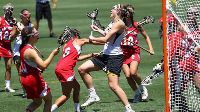Mia Castagnero (10) on defense for Apex. Charlotte Catholic High School travels to Cary N.C. on Saturday, May 24, 2014 for NCHSAA Girls Championship 4A Lacrosse. After a very close battle, Charlotte edges Apex by one to win 10 - 9. (Chris Baird / WRAL Contributor)