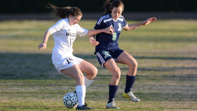 Nevada Mareno (9) and Alexa Asher (14) battle for the ball. Leesville Road and Millbrook battled to a 0-0 tie on Wednesday, Mar. 26, 2014. (Photo by: Nick Stevens)