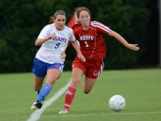 Hoggard's Rebecca Fowler with the ball. The West defeated the East 4-1 in the NCCA East-West All-Star Girls Soccer Game on Tuesday, July 22, 2014. (Photo By: Nick Stevens/HighSchoolOT.com)